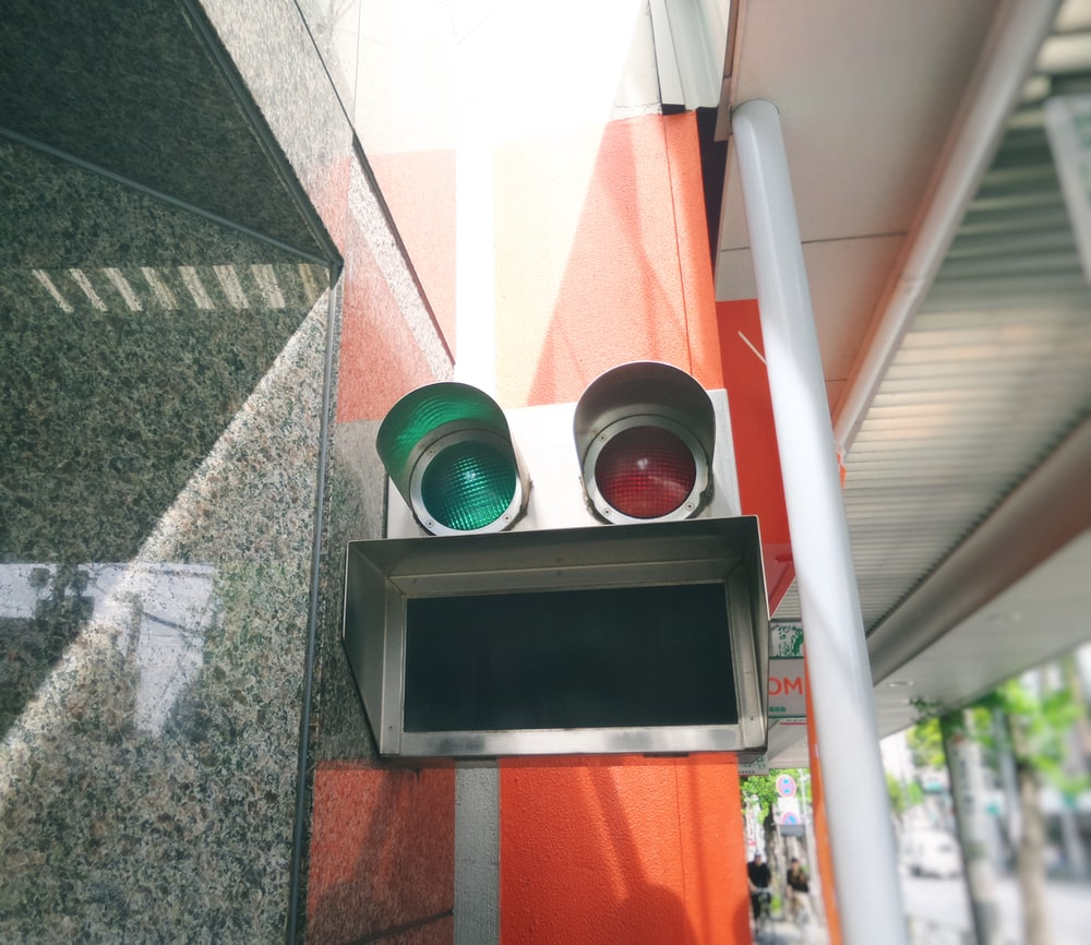 red and green street signal lights