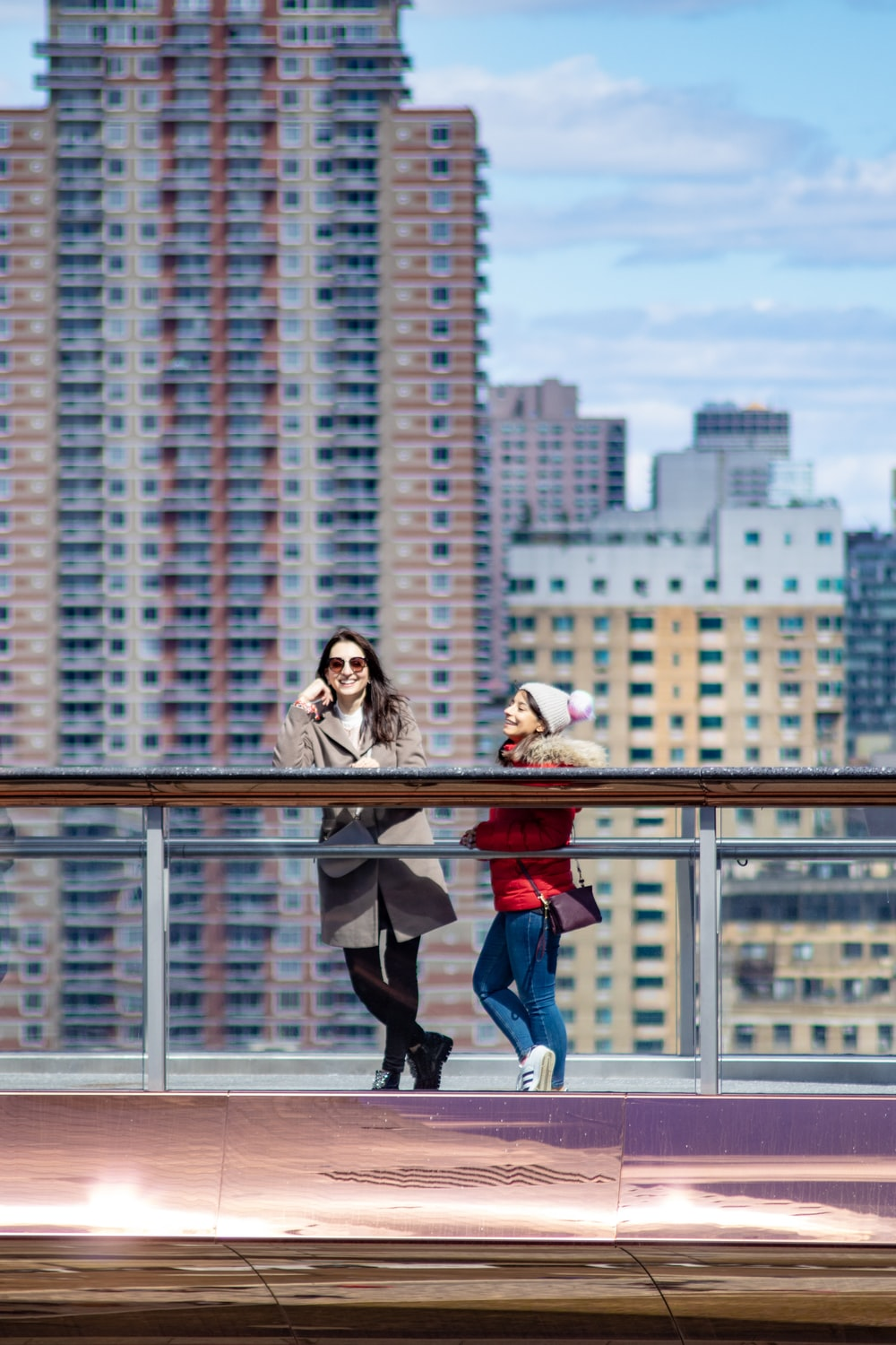 two people standing near buildings