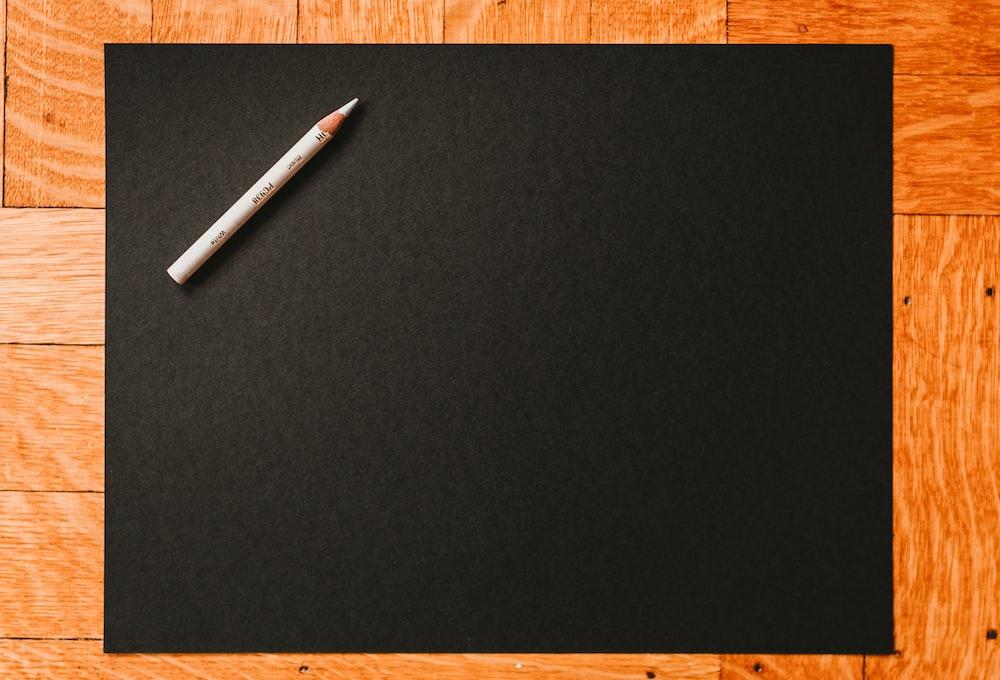 white coloring pencil on blackboard