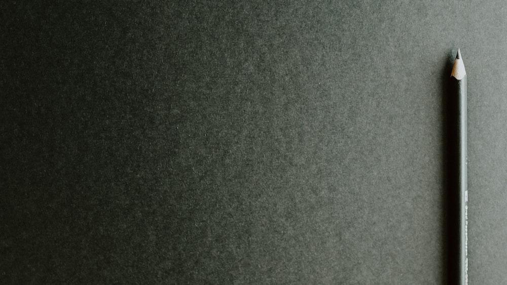 black pencil on black surface