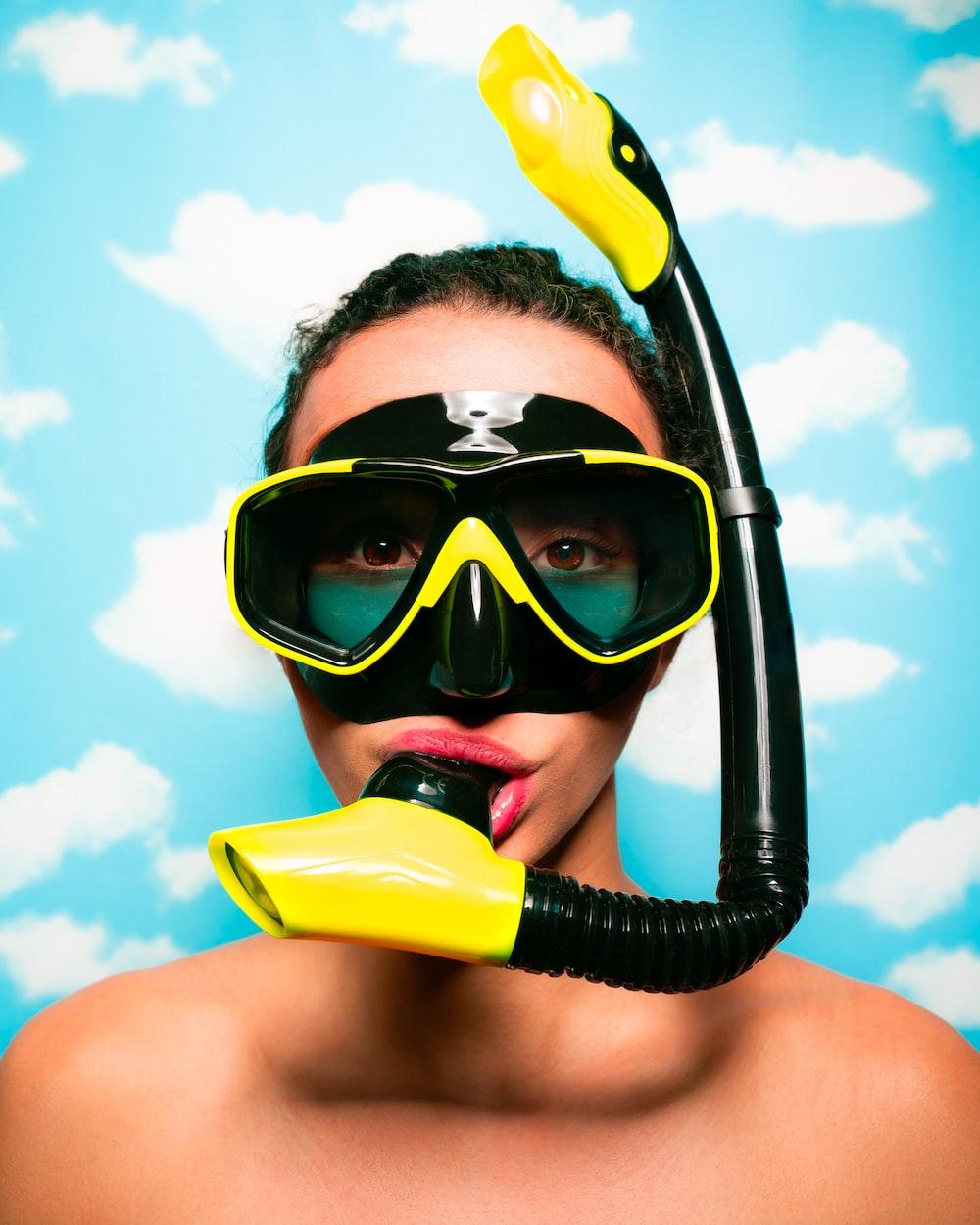 woman wearing black and white scuba gear