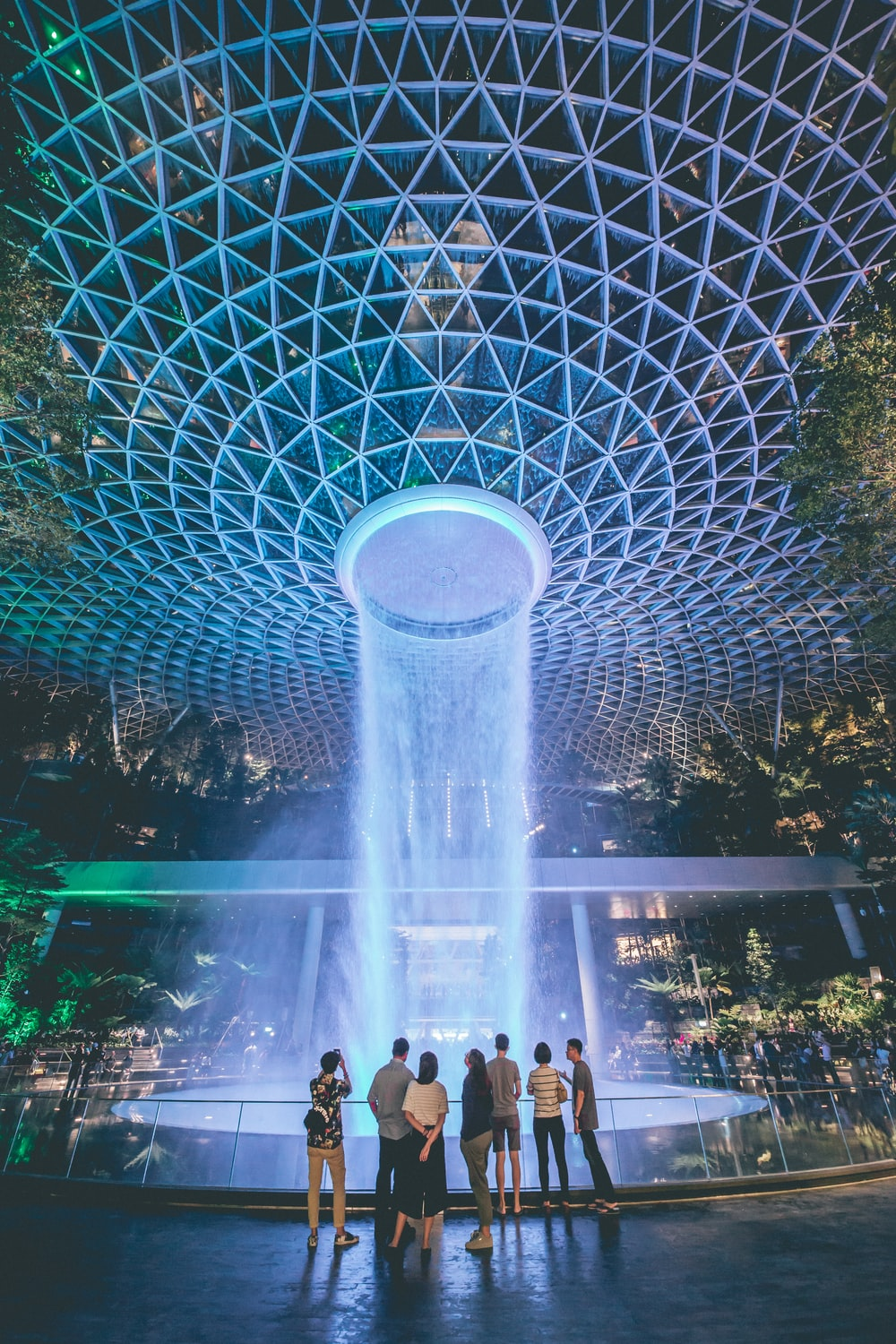 people standing in front of lighted water fountain