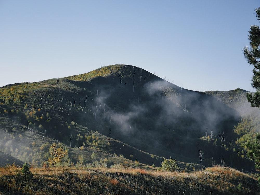 green hills white smokes photo