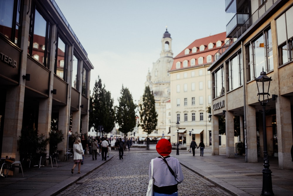 woman walking near the building