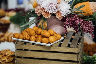 brown meatballs in white tray events zoom background