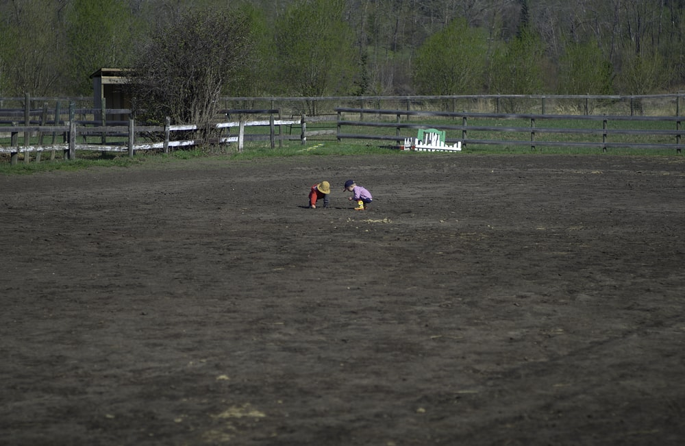two children playing on ground
