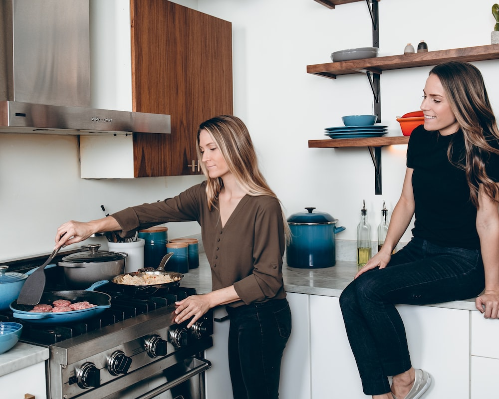 two woman in kitchen