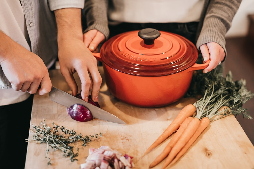 round orange pot beside vegetables