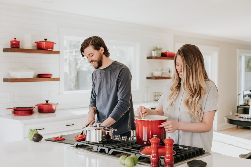 man and woman on kitchen