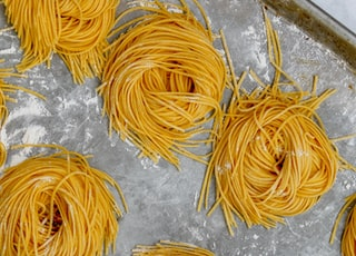 yellow noodles in tray