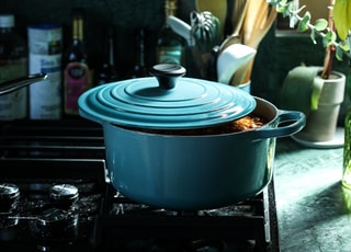 partly opened blue metal pot on stove
