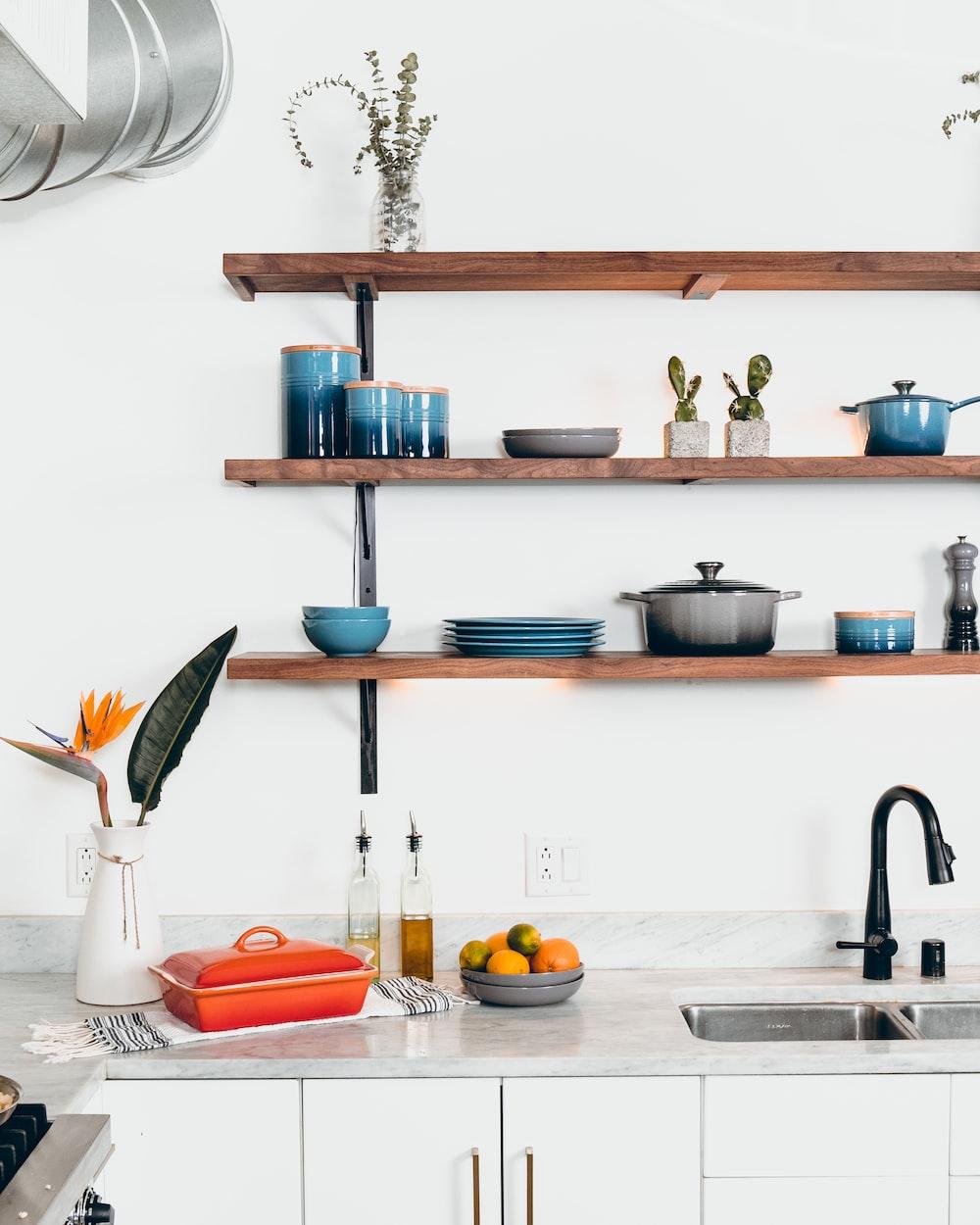 blue ceramic dinnerware on rack