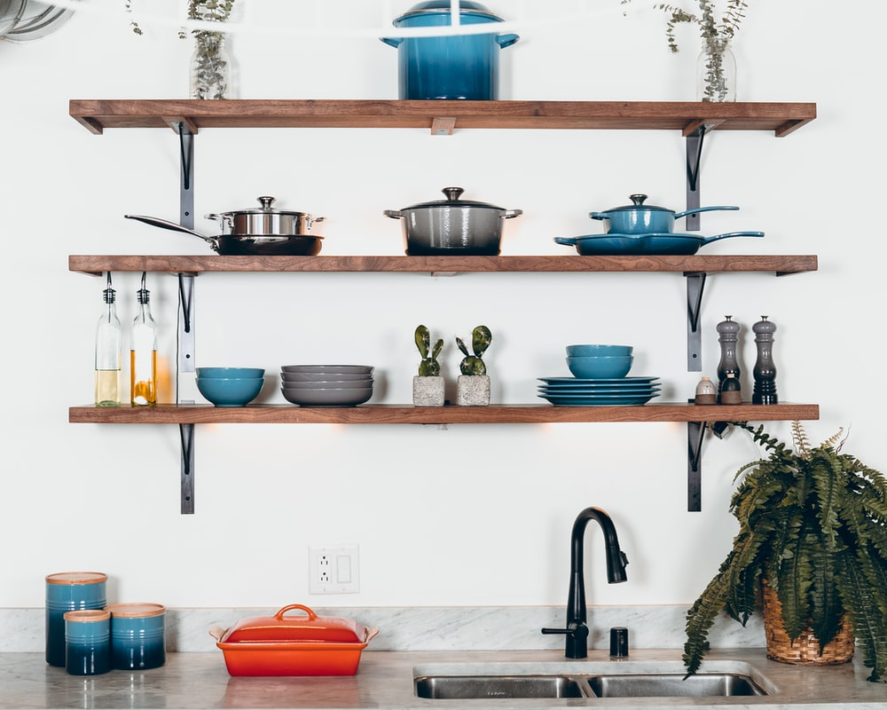 cookware set on floating shelves