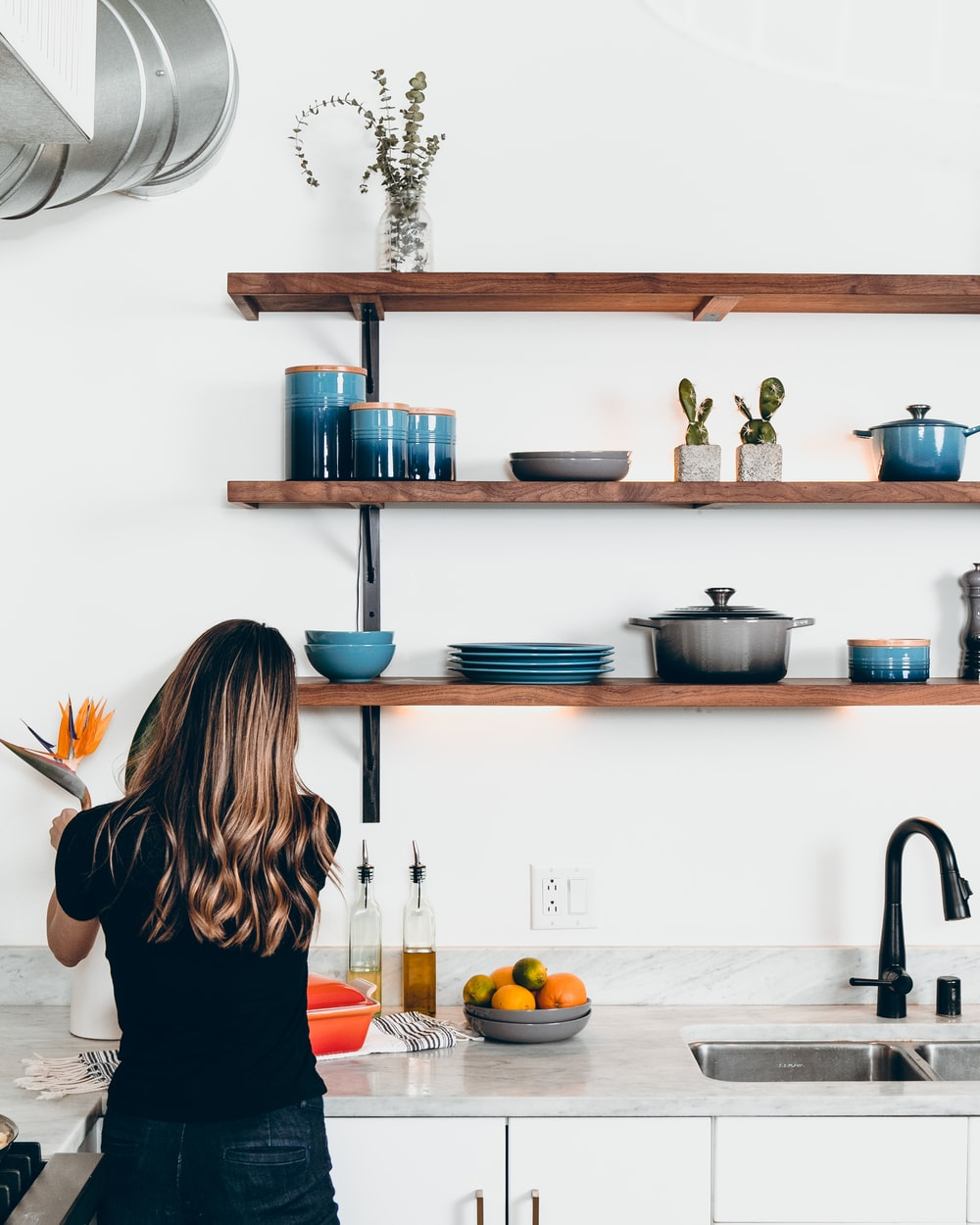 woman standing in front of kitchen sink