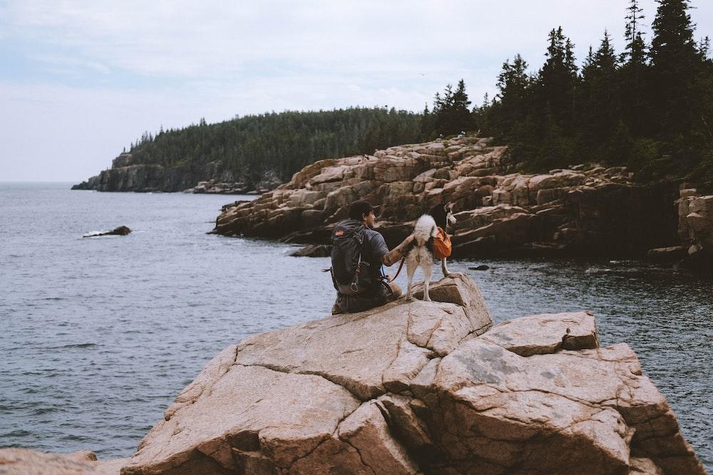 man sitting on rocks