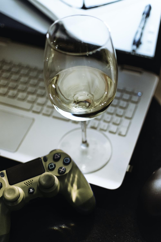 wine glass on laptop