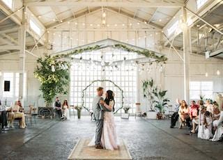 groom and bridge dancing inside building during daytime