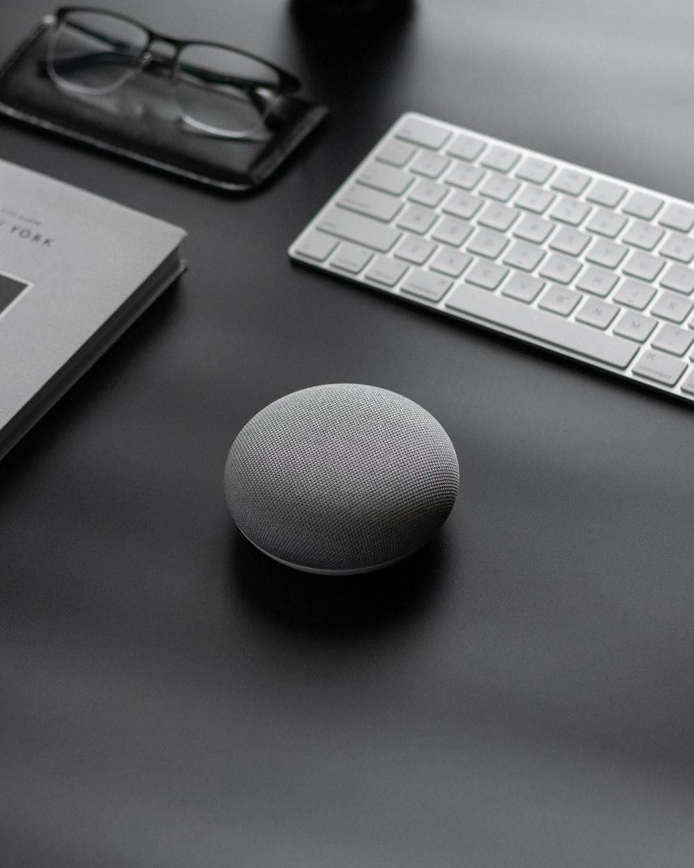 round gray Google Home Mini speaker