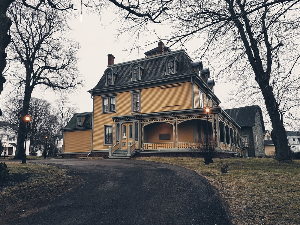 beige concrete 3-storey house