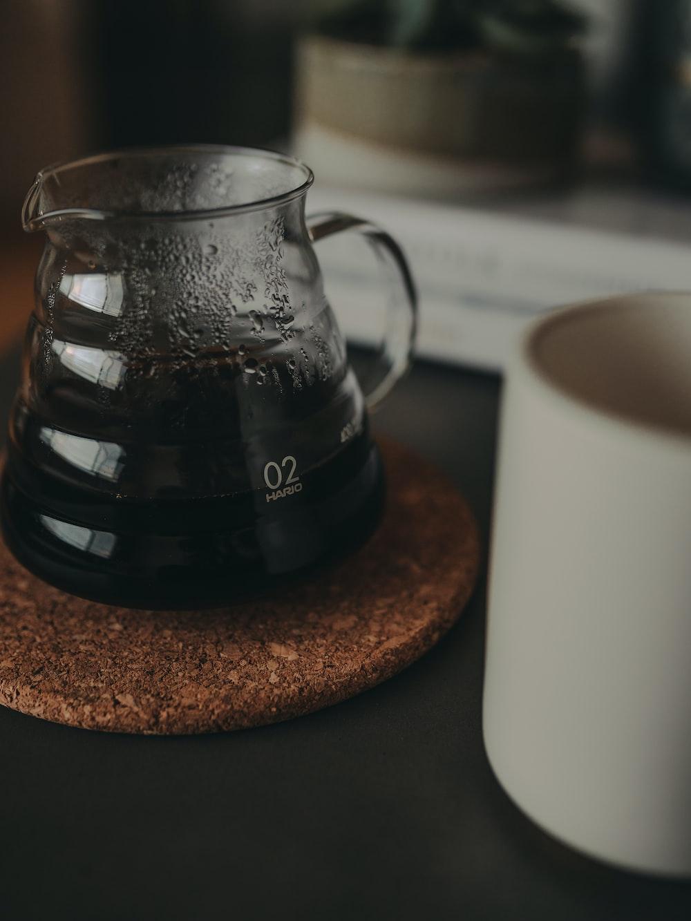 clear glass pitcher and white ceramic mug