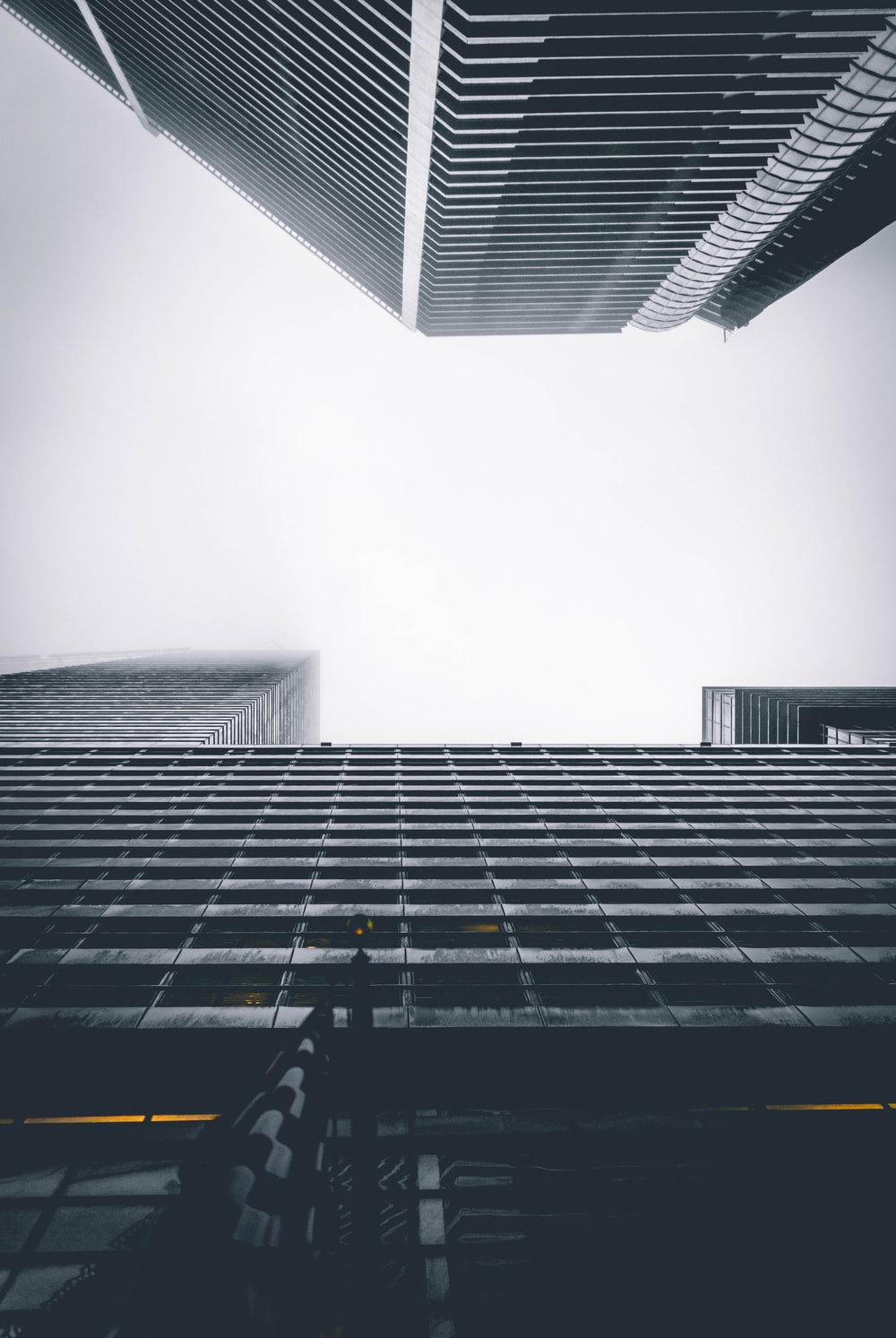 two buildings under white sky during daytime