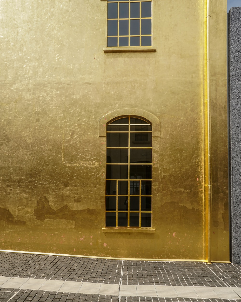 gold-colored concrete building