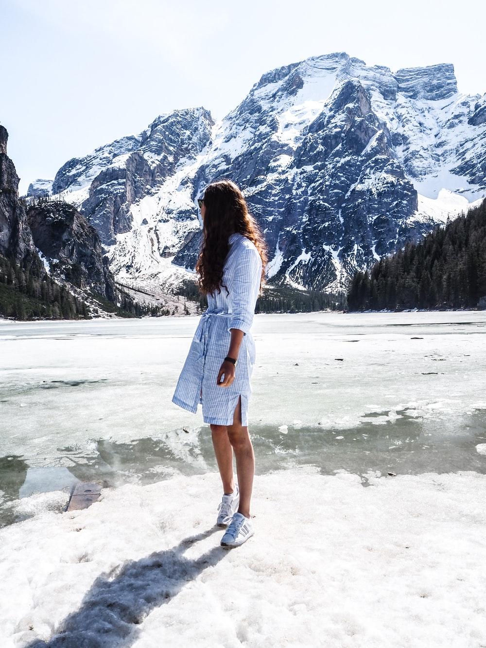 woman standing near snow covered field during daytime