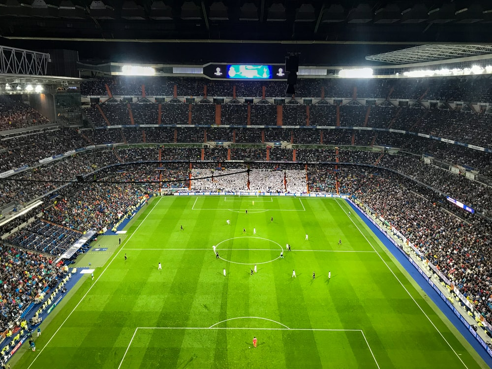 aerial photography of soccer game inside stadium