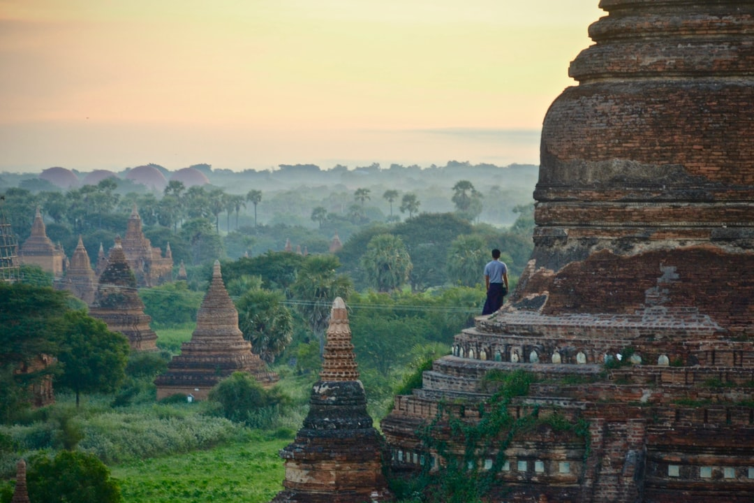 Watching sunrise in Bagan with the hot air ballons rising in the sky.
