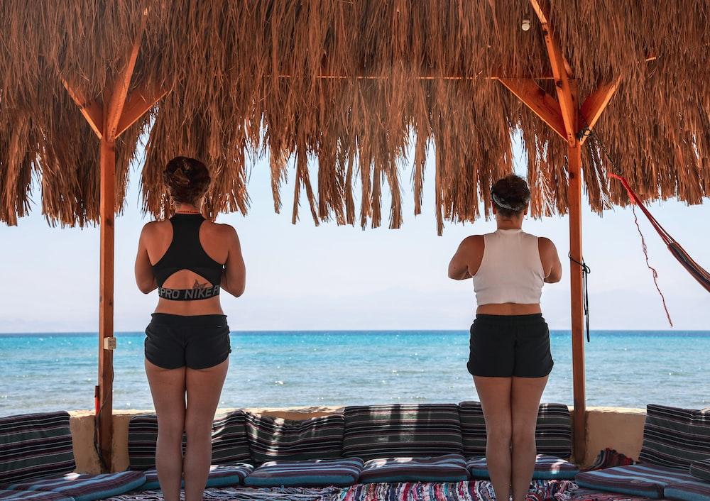 two women under hut