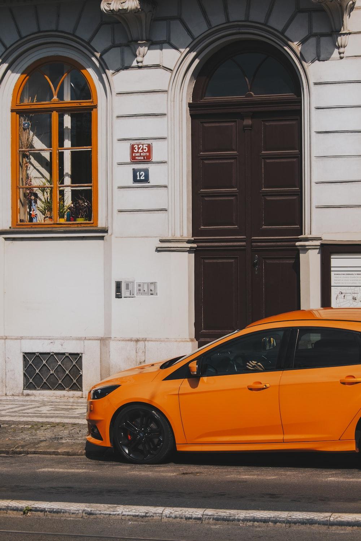 yellow vehicle near building
