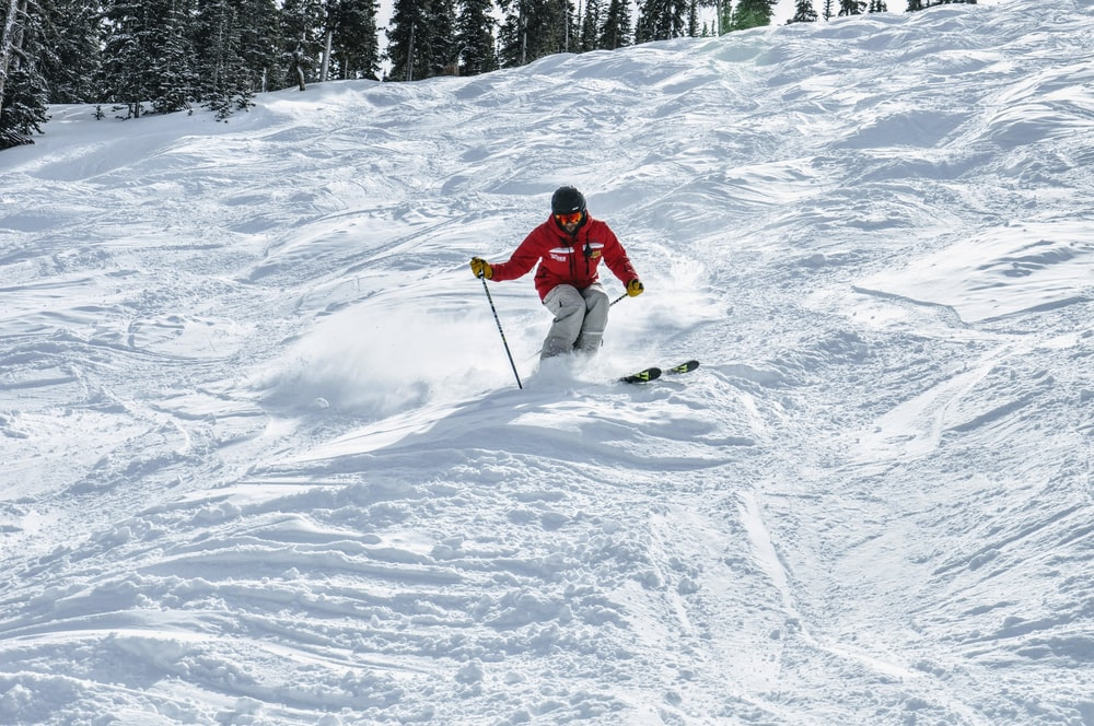 person skiing in a snow during daytime