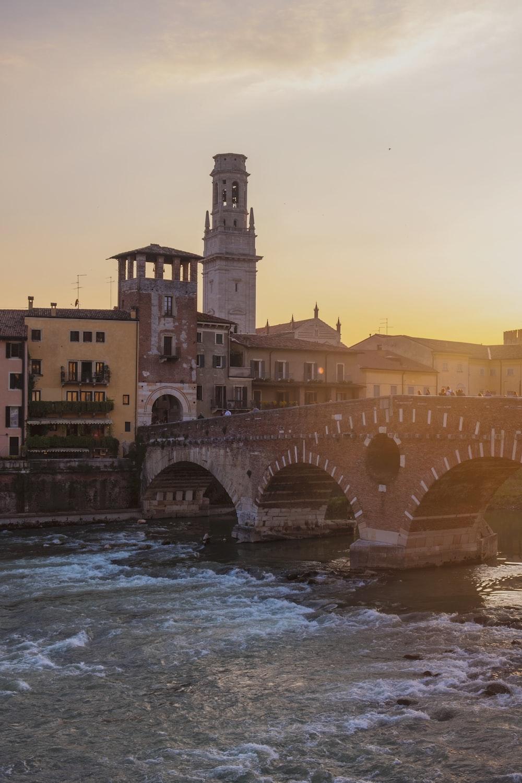 concrete bridge over rippling waters