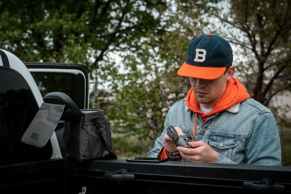 men's black and orange cap