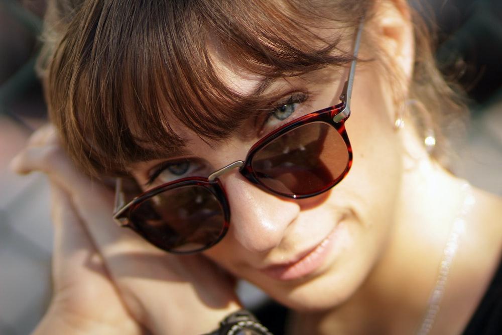 women's black and red tortoiseshell-framed sunglasses