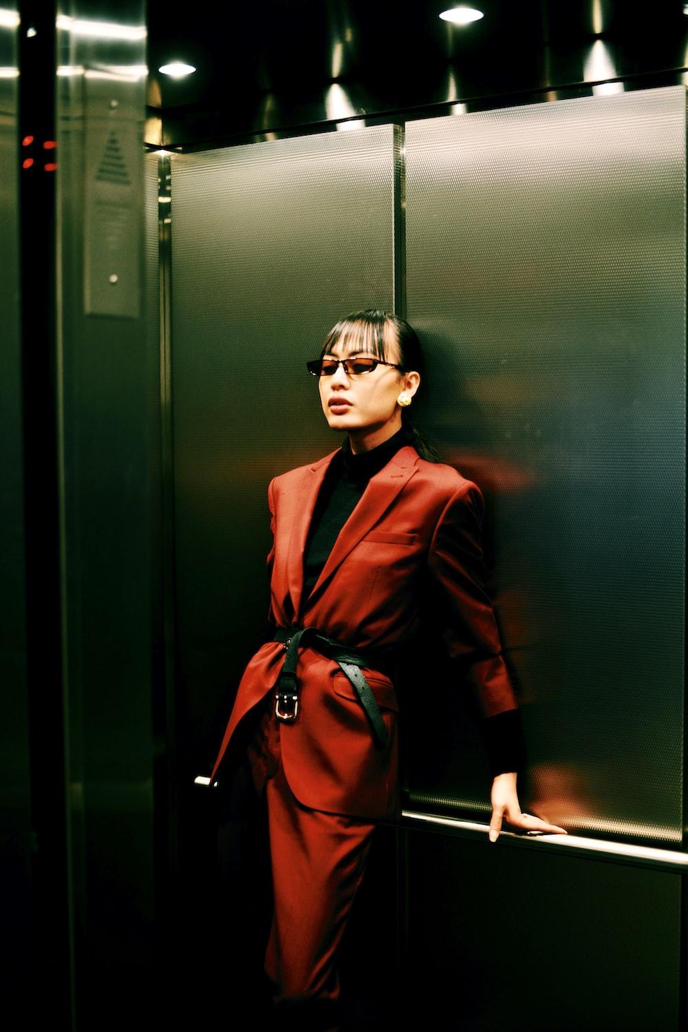 woman in red blazer in elevator