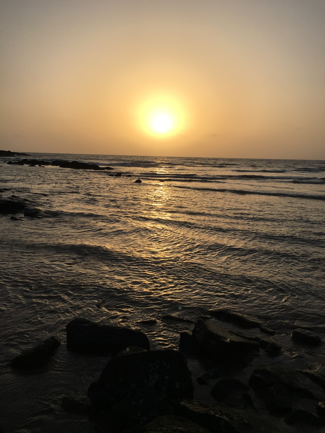 This photograph is taken on aksa beach in sunset view,the waves were on low tide