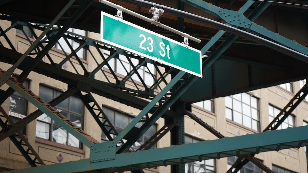23 street signage hanged on metal bars