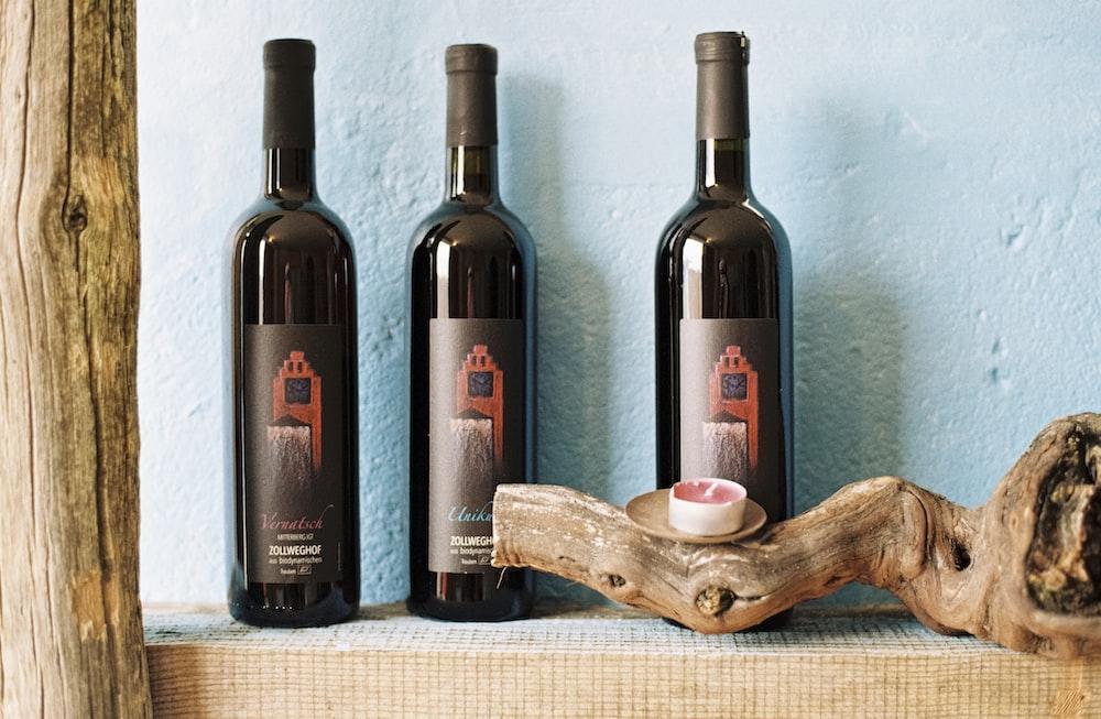 three black labeled bottles