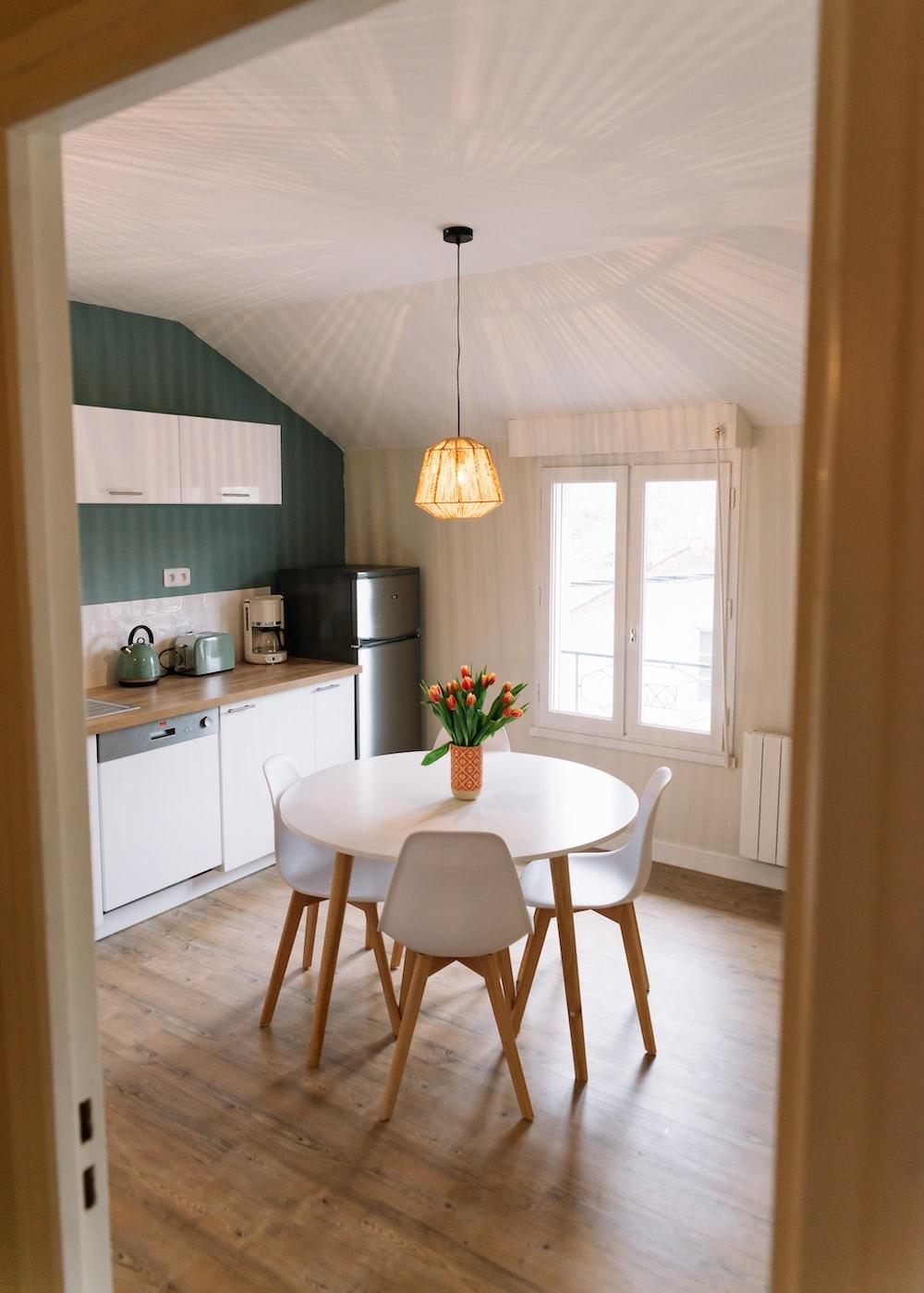 Astonishing Round Brown Wooden Frame White Wooden Dining Table Set Photo Inzonedesignstudio Interior Chair Design Inzonedesignstudiocom