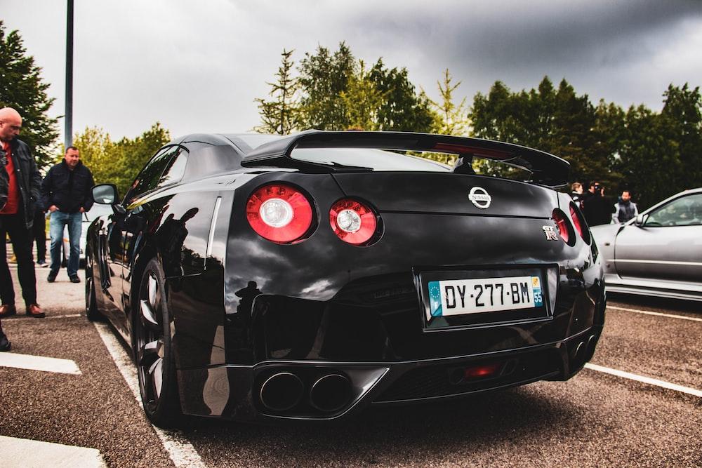 black Nissan vehicle