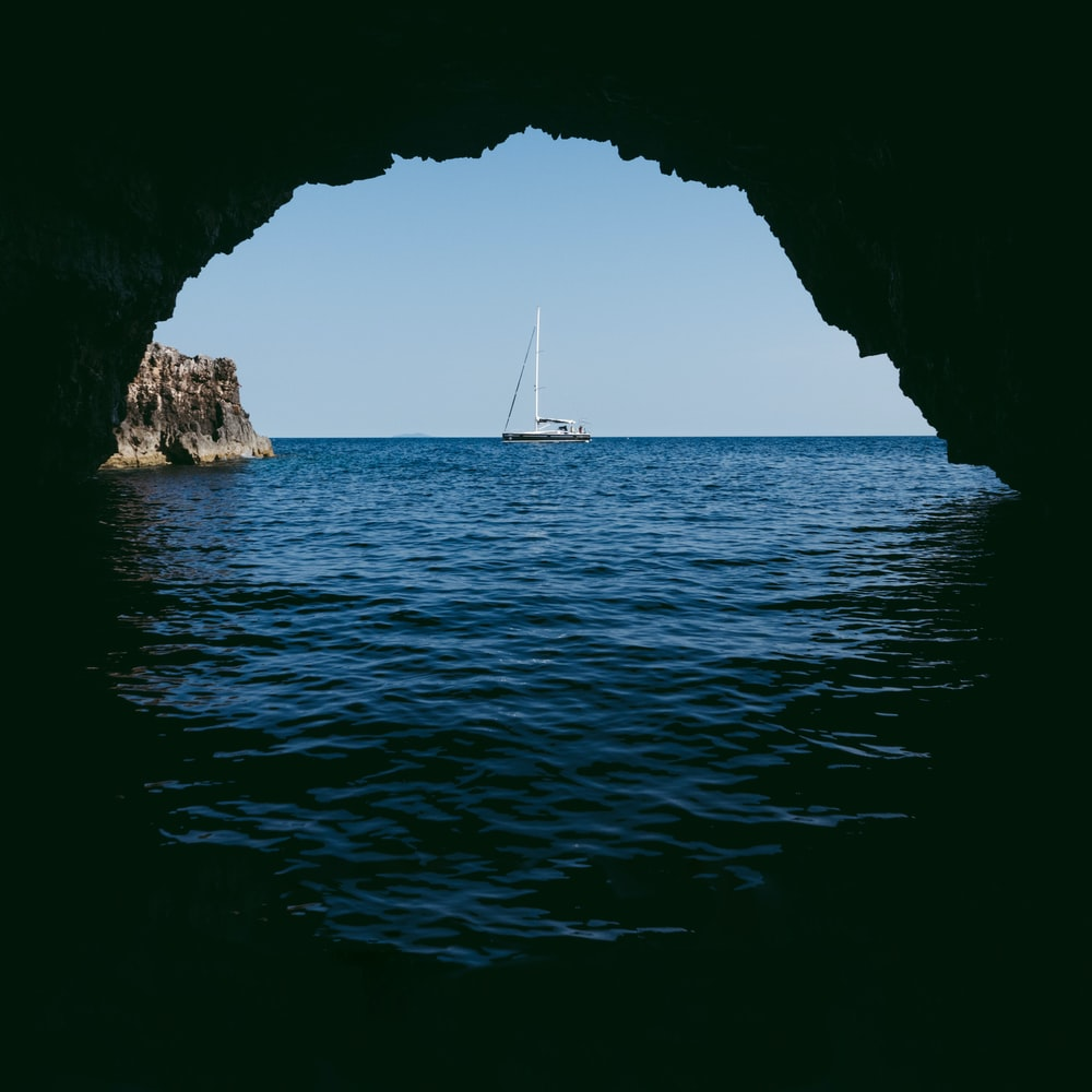 cave in the ocean viewing boat at distance