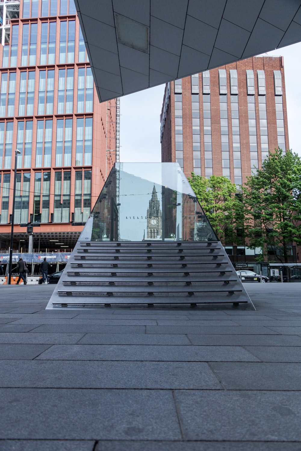 stairs with clear glass case near buildings
