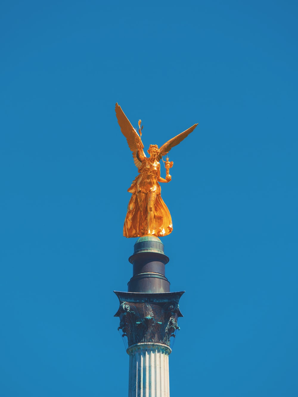 gold angel statue on tower