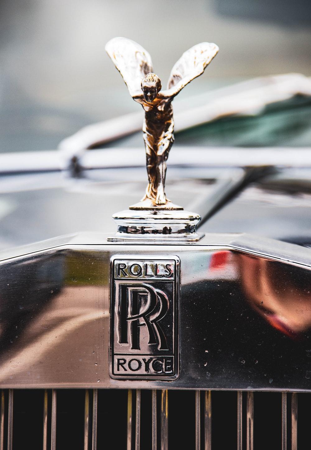 shallow focus photo of Rolls Royce emblem