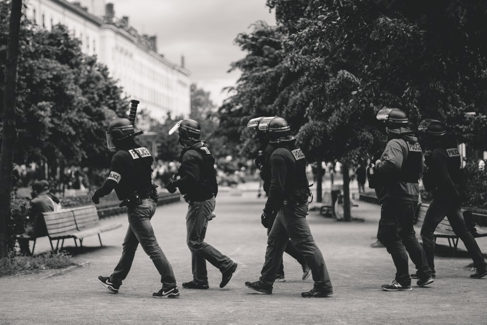 policemen walking on park