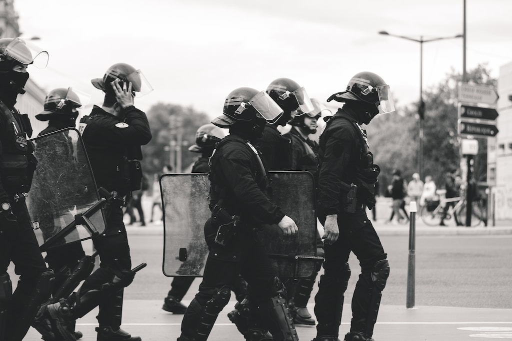 group of police grayscale photo