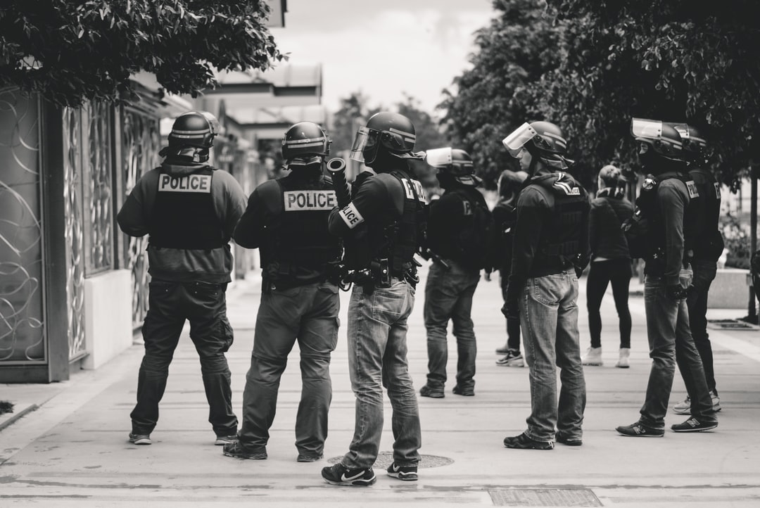 """High police presence in Lyon, France, during the 25th weekend of the yellow vests movement.  Police violence is at its highest since the 1950s. There is an extensive use of tear gas, sting-ball grenades and LBDs (""""defense ball launchers"""") against largely peaceful protesters. The policeman in the middle holds a LBD. The use of LBDs, that can cause serious injusries, is highly controversial. As of now (May 5th), 292 persons claim to be seriously injured by rubber balls, 23 persons lost an eye and 5 persons their hand during protests (source: mediapart.fr, http://tiny.cc/6hd85y)."""