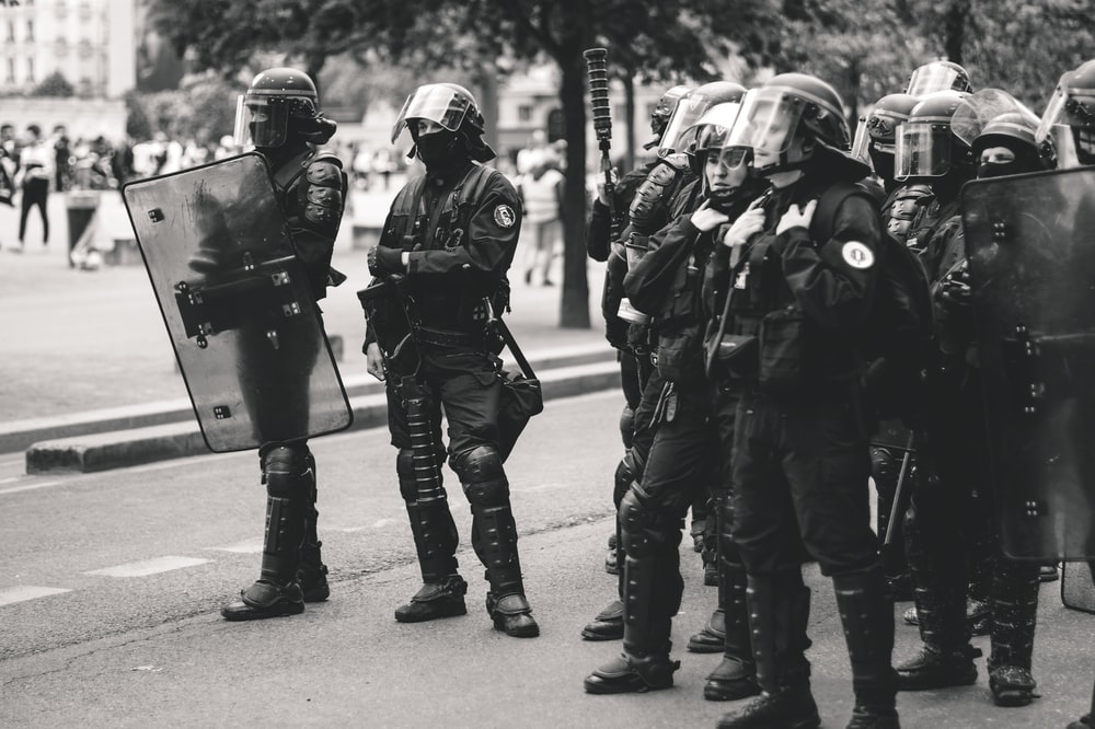 officers standing on road during daytime