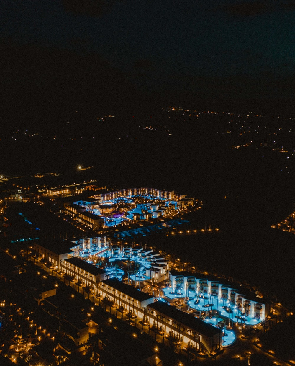 top view of blue lighted buildings
